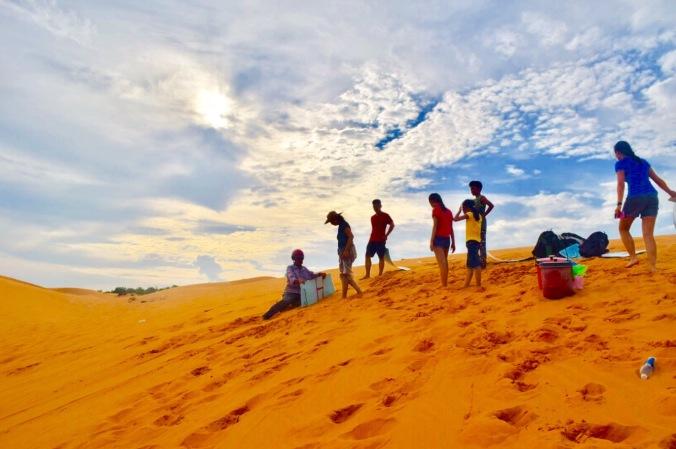 toddler in mui ne, toddler in red sand dunes, mui ne trip , mui ne red sand dunes, sand boarding